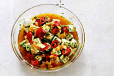 Закуска из сыра в масле с пряными травами, чесноком и чили.