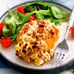 Куриные бёдрышки, запечённые под сырным кремом.
