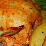 Запеченный цыпленок с томатами.